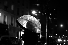 Under the lit umbrella (pascalcolin1) Tags: paris13 homme man nuit night pluie rain parapluie umbrella lumière light voitures cars street photoderue streetview urbanarte noiretblanc blackandwhite photopascalcolin 50mm canon50mm canon