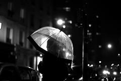 Under the lit umbrella (pascalcolin1) Tags: paris13 homme man nuit night pluie rain parapluie umbrella lumière light voitures cars street photoderue streetview urbanarte noiretblanc blackandwhite photopascalcolin 50mm canon50mm canon