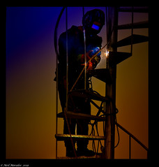 The welder. (Neil. Moralee) Tags: neilmoralee man weld welder mask stairs spiral sparks colour color olympus omd em5 neil moralee gradient work worker menatwork trade tradesman craft craftsman professional arc arcwelder ropes hight cyprus troodos crew