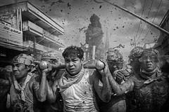 The Mood Of The 9 Emperor (Mio Cade) Tags: firecrackers bombardment ritual religion thailand phuket smoke men devotee sedan danger hot hurt monochrome shower statue god documentary reportage