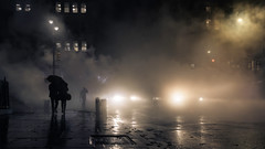 Grounded (onefivefour) Tags: newyork manhattan nyc night dark rain steam fog smoke sidewalk lights silhouette backlight glow cold winter umbrella