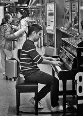 Playing Goodbye (millwall.rl) Tags: london underground tube piano man women people acros