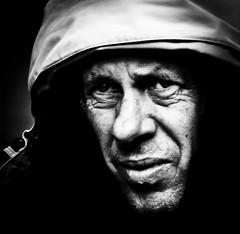 under the weather (Gerrit-Jan Visser) Tags: geimporteerd street portrait bnw blackandwhite amsterdam shadow raincoat under weather