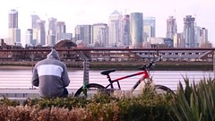 Back to the Future (No Great Hurry) Tags: nogreathurry isleofdogs city riverthames thames river hoodie cyclist greenwich canarywharf london robinmauricebarr backtothefuture