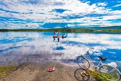 Peaceful border (ikkasj) Tags: nordic summer muonio muonioriver finland laundry rugs