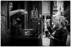 Anticipation is the greatest joy. (Loek van Straaten) Tags: lübeck germany street streetphotography candid city people woman lady salesman seller sausagestand blackandwhite black white bw monochrome loek vanstraaten