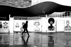 Under the women gaze (pascalcolin1) Tags: paris13 homme man women femmes regard look gaze pluie rain reflets reflection poster affiches photoderue streetview urbanarte noiretblanc blackandwhite photopascalcolin 50mm canon50mm canon