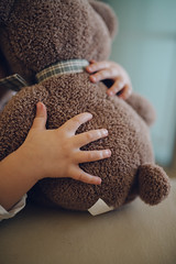 Little girl hugs teddy bear. Closeup arms. (shixart1985) Tags: home house livingroom indoors cute beautiful toy funny happy child family room leisure sofa lifestyle sit happiness animal apparel bear clothing face hug love lovey loving play special squeeze teddy adorable apartment barefoot bed bedroom cheerful childhood comfort copy space cozy domestic embrace excited flat glad interior joy kid little lovely nursery pleasure plush relax rest soft weekend