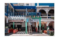 F3406 ~A very busy scene in Essaouira (Teresa Teixeira) Tags: morocco essaouira travel travelphotography colours teresateixeira holidays light busyscene restaurant restochezali shops man painting