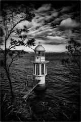 Little Lighthouse in the Harbour (Peter Polder) Tags: australia architecture bw building bay clouds seascape harbour sky sea overcast water sydney z