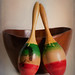 Two Vintage Maraca Leaning against a bowl