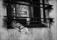 Serait-ce une ville sans poubelle? /   May be it is a city without trash? (vedebe) Tags: bouteilles abandonné bouteille bottles fenêtre ville city rue street urbain urban noiretblanc netb nb bw monochrome plastique verre écologie société pollution