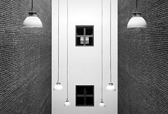 Arrangement of Lamps and Windows (HWHawerkamp) Tags: maastricht lamps wall window abstract interior bricks bw netherlands architecture