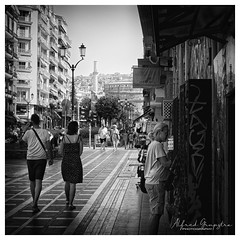 Shopping In Grafitti (Alfred Grupstra) Tags: blackandwhite people urbanscene cultures oldfashioned street city retrostyled history citylife outdoors old men women walking monochrome architecture illustration famousplace travel