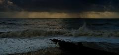 Rain shower (Blue Rock Fox) Tags: clouds weather rain raincloud sea ocean water coast beach southcoast southeastcoast breakwater dark moody outdoors cooden coodenbeach eastsussex sussex fujixpro2 waves storm shore davidbellis davebellis davidmichaelbellis bluerockfox highshutterspeed intothelight intothesun eveningsun dusk