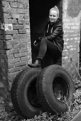 Marie # 12 (just.Luc) Tags: vrouw femme donna mujer woman frau jong young jeune jung portret portrait ritratto retrato porträt face gezicht visage gesicht bn nb zw monochroom monotone monochrome bw tyres pneus banden autobanden