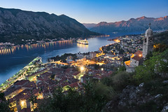 Kotor Bay and the sunset (Luís Henrique Boucault) Tags: sky summer adriatic travel castle mediterranean nature europe cityscape coast oldtown montenegrolandscape destination bay old view boat balkans tourism kotorbay montenegromountain marina still landmark famous mountain night mountains sea fjord city kotor ancient cathedral tower landscape sunset ship nicepicture town church bayofkotor montenegro oldtownperast architecture island panorama harbor christianity montenegrokotor
