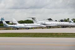 Sheltair Flightline KFLL (CanAmJetz) Tags: nikon n363wc ppsvg msqar cessna citation gulfstream kfll fll bizjets flightline global express bombardier n826ew