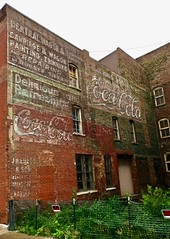 Ghost Wall, Burlington, IA (Robby Virus) Tags: burlington iowa ia ghost sign signage signs painted brick wall ad advertisement faded forgotten cocacola coke carriage wagon repairing central