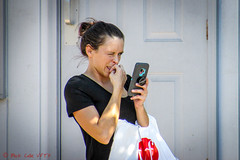Squinting (ViewFromTheStreet) Tags: allrightsreserved berks berkscounty blick blickcalle blickcallevfts calle copyright2019 pennave pennavenue pennsylvania photography readingpa stphotographia streetphoto streetphotography tompkins vfoutlet viewfromthestreet westreading westreadingpa amazing bag bun candid cell classic female girl hairbun mobile phone portrait reading shopping squint street streetportrait vftsviewfromthestreet woman ©blickcallevfts ©copyright2019blickcalle