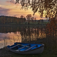 Blue boat (Stefano Rugolo) Tags: stefanorugolo pentax k5 pentaxk5 kepcorautowideanglemc28mm128 kmount blueboat blue boat autumn sunset tree lake reeds sky water landscape impression clouds reflection sweden hälsingland