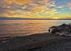 The photographer (Adaptabilly) Tags: horizon log victoria bc sunset water britishcolumbia clouds man beach silhouette juandefuca photography sky canada iphone tripod rocks waves