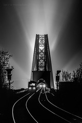Last Train (ianrwmccracken) Tags: floodlight night d750 silhouette bridge shadow engineering train telephoto mono railway lowlight rail structure contrast highlight leading lines