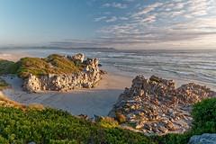 Grotto Beach (Tjaldur66) Tags: sea seashore coast coastline ocean beach rocks clouds rockformation waves wilderness evening eveninglight nature goldenhour sunset southafrica westerncape overberg hermanus voëlklip travel