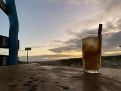 Caipirinha, Bar Atardecer (Sunset Bar), Puerto Villamil, Isabela Island, the Galápagos Islands, Ecuador. (ER's Eyes - Our planet is beautiful.) Tags: island ecuador unesco worldheritagesite charlesdarwin biospherereserve isla ilha isabela equador thepacificocean theoriginofspecies oceanopacífico arquipélago islaisabela queenisabela galápagosnationalpark lasislasgalápagos thegalápagosislands lasgalápagos ilhaisabela ilhasdoarquipélagosdasgalápagos archipiélagodecólon elocéanopacífico thegalápagosmarinereserve elparquenacionaldegalápagos isabelaalbemarleisland reinaisabelidecastilla isabelaislandgalápagos thedukeofalbermarle laislaisabela sunsetbar poente baratardecer barpoente sunset praia beach bar caipirinha cachaça puertovillamil villamilpier villamildock