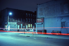 (patrickjoust) Tags: fujica gw690 fujichrome t64 6x9 medium format 120 rangefinder 90mm f35 fujinon lens cable release tripod long exposure night after dark manual focus analog mechanical chrome slide e6 color reversal expired discontinued tungsten balanced film patrick joust patrickjoust baltimore maryland md usa us united states north america estados unidos urban street city west side corner store lees market lieberman cleaners sign greatestcityinamerica bench light streak stream row house home brick