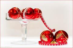 baubles (sure2talk) Tags: baubles smileonsaturday christmas red ribbon nikond7000 nikkor50mmf14gafs flash speedlight sb900 offcamera diffused softbox flickrfriday glass scavenger6 ansh ansh1016baubles