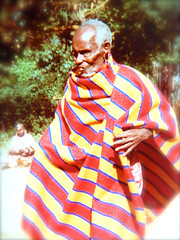 Old Man at Masai Village (Dave Redman pics) Tags: oldman masai masaivillage greatgreat rift valley kenya nairobi robe red yellow stripes culture cultural
