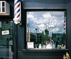 The Barber Shop (Dalliance with Light (Andy Farmer)) Tags: barbershop street girardave window philly philadelphia provia100f slidefilm film fishtown pennsylvania unitedstatesofamerica 35mm nikonfm2 fujifilmprovia100f zeiss50mmplanart