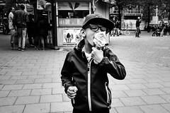 Boy with Ice cream (A.Johansson) Tags: streetphotography street blackwhite bnw monochrome boy icecream glasses cap fujifilm fuji spring may 23mm xt10 stockholm kungsträdgården eating candid candidphotography softicecream focus focused