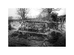 Forlorn resting place (G. Postlethwaite esq.) Tags: bw derbyshire stmichaelschurch suttononthehill unlimitedphotos blackandwhite churchyard graves lateautumn mist monochrome photoborder