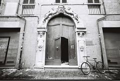 Entrance (goodfella2459) Tags: nikonf4 afnikkor14mmf28dlens cinestillbwxx 35mm blackandwhite film analog rimini italy door bike building bwfp