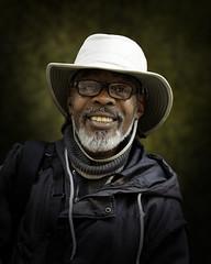 Joseph (mckenziemedia) Tags: man portrait portraiture face hat glasses smile people humanity homeless homelessness chicago city urban street streetphotography