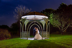 Wedding shot at the Moorland Garden Hotel on Dartmoor.  Rebecca and Carl - backlit in the dark under the Rose Arbour (pgosling1979) Tags: hotel garden moorland arbour rose wedding