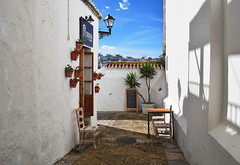Sunny Days (Jocelyn777) Tags: streets architecture buildings pavements cobblestones chairs villages towns whitevillages pueblosblancos vejerdelafrontera andalucia spain travel