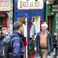 Twice as nice (Frank Fullard) Tags: frankfullard fullard candid street portrait shop sign nice color colour galway irish ireland walking walker gentleman whitehaired square