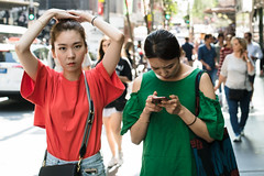 Duet (McLovin 2.0) Tags: xmas red green candid people girls street streetphotography style fashion arms eyes beauty sony a7s 55mm zeiss portrait urban city sydney