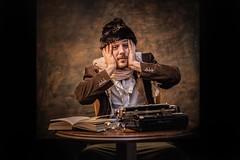 Writer's block (Dannis van der Heiden) Tags: writer typewriter hat glasses book shawl table writersblock chair d750 lensbaby twist60 jeroen persona cccfotounie man male