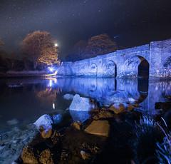 Night Time in Buncranna (Benjamin Driver) Tags: buncrana bridge nightphotography night nightscape river sea water spring stars blue orange stitched stitch