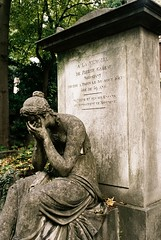 PL3-057-27 (David Swift Photography) Tags: davidswiftphotography parisfrance perelachaisecemetery sculpture statues monuments graves tombs sorrow sadness historiccemeteries 35mm film nikonfm2 kodakportra