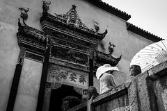 Perfection is unreal (Go-tea 郭天) Tags: chongqing républiquepopulairedechine old ancient traditional tradition history historical historic building construction door past present up upstairs down downstairs umbrella sunshade hat sun sunny shadow lady woman dress luxury level alone lonely beautiful beauty street urban city outside outdoor people candid bw bnw black white blackwhite blackandwhite monochrome naturallight natural light asia asian china chinese canon eos 100d 24mm prime back backside