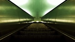 Escalators Symmetry at the Alex (ANBerlin [Ondré]) Tags: stadtleben stadtansichten städtisch stadt citylife cityscape urban city strasenfotografie streetphotography ausergewöhnlich extraordinary struktur structure abstrakt abstract innen indoor inside stahl steel stufen stairs grün green linien lines schatten shadow licht lights reflektion reflexion reflection fliesen tiles rolltreppe escalators unterführung underpass untergrund underground bauwerk building architektur architecture infrastruktur infrastructure bahnhof station bahnsteig platform ubahn metro subway deutschland germany berlin mitte alexanderplatz alex anb030 shotoniphone iphotography iphonography 8plus iphone8 iphone apple