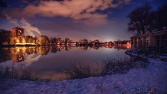 calm night (Slávka K) Tags: bluehour blue evening colors quiet houses winter december 2019 snow sky clouds lake mirror reflection natur landscape country orange light water city slovakia trees