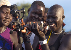 Mundari tribe women laughing while watching themsleves on the screen of a camera, Central Equatoria, Terekeka, South Sudan (Eric Lafforgue) Tags: adults adultsonly africa camera centralequatoria colourimage day eastcentralafrica groupofpeople holidays horizontal indigenousculture journey mundari osmo outdoors pastoralist southsudan ssdn7856 terekeka tourism tourist travel traveldestination tribal tribe trip vacation vacations women womenonly