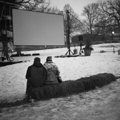 untitled (kaumpphoto) Tags: rolleiflex 120 tlr ilford hp5 bw black white screen street urban city pair couple minneapolis hay bale sit seat waiting composition holidazzle people