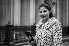 Spotted (Leanne Boulton) Tags: urban street candid portrait portraiture streetphotography candidstreetphotography candidportrait streetportrait eyecontact candideyecontact streetlife woman female girl pretty face eyes expression mood feeling emotion mobile phone smartphone fur furry coat spotted pattern tone texture detail depthoffield bokeh naturallight outdoor light shade style fashion city scene human life living humanity society culture lifestyle people canon canon5dmkiii 70mm ef2470mmf28liiusm black white blackwhite bw mono blackandwhite monochrome glasgow scotland uk